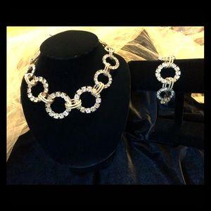 Gold rhinestone necklace and bracelet set.